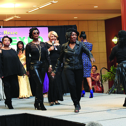 Fashion show coordinator Jan Reynolds (center, with microphone) and her models offered an array of dazzling styles from Macy's, Sears and Zoom de Italy.