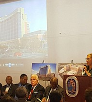 Betty Hager Francis (at podium), deputy administrator for Prince George's County's Department of Health, Human Services and Education, speaks during a ceremony at the Boulevard at the Capital Centre in Largo on Oct. 21 to celebrate the state's formal approval of a state-of-the-art hospital proposal in the county.