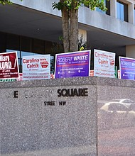 Campaign signs are seen outside the One Judiciary Square building in northwest D.C. on Saturday, Oct. 22 as early voting gets underway in the city.