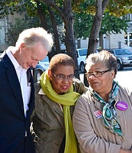 From left: D.C. Council member Jack Evans (D-Ward 2), D.C. Del. Eleanor Holmes Norton (D) and Council member Anita Bonds (D-At Large) attend a rally at the One Judiciary Square building in Northwest on Saturday, Oct. 22 as early voting gets underway in the city.