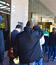 Hundreds of D.C. residents stand in line at the One Judiciary Square building in Northwest on Saturday, Oct. 22 as early voting gets underway in the city.