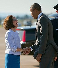 Governor Kate Brown and President Barack Obama at the Oregon Air National Guard Base in Portland in May of 2015.