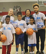 The Portland Trail Blazers celebrate National Junior NBA Week by hosting a basketball clinic last week at the Blazers Boys and Girls Club on Northeast Martin Luther King Jr. Boulevard, Pictured (back row, from left) are Boys and Girls Club of Portland adult leaders Hannah, Imani and Omar and (front row, from left) youth participants King, Simone and Jaden.