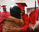 Some of the 11 students of the first and last graduating class of Livingston High School celebrating after their commencement June 3, 2008, in New Orleans. The school was set to close that summer with plans for a new elementary school to be built on the grounds.