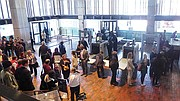 Boston residents line up to cast ballots in early voting at City Hall.