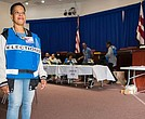 Election official Cassandra Lewis waits to welcome voters at an early-voting poll station in Washington, D.C., on Oct. 25, 2016.
