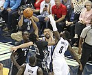 The Memphis Grizzlies tipped off their 15th season in the Bluff City on Wednesday with a rousing 102-98 victory over the up and coming Minnesota Timberwolves. Above, James Ennis III goes high to block Wolves forward Andrew Wiggins. (Photo: Warren Roseborough)