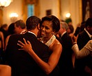 President Barack Obama and First Lady Michelle Obama dance while the band Earth, Wind and Fire performs at the Governors Ball in the State Dining Room of the White House February 22, 2009.