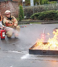 Portland Fire and Rescue personnel give a lesson on fire suppression to students from the Youth Disaster Academy at Benson High School in northeast Portland.