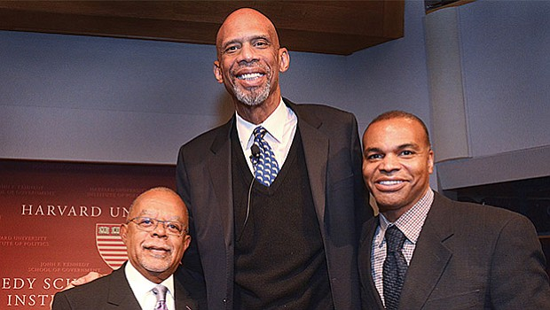 """Basketball champion, activist and best-selling author, Kareem Abdul-Jabbar (center) is joined by Henry Louis Gates Jr. (left), professor and director of the Hutchins Center at Harvard University, and Harvard basketball coach Tommy Amaker, after his interview with Gates regarding the social and political issues facing America. Abdul-Jabbar was also promoting his latest book, """"Writings on the Wall: Searching for a New Equality Beyond Black and White."""""""