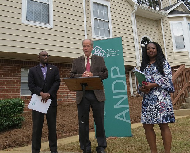 District 3 Commissioner Larry Johnson, ANDP President and CEO John O'Callaghan, and new homeowner Lakesha Head help kick off the Nov. 2 launch of the $1 million Homebuyer Assistance Program.
