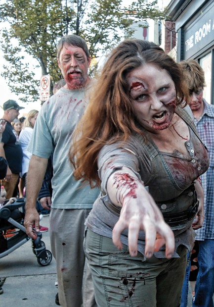Zombies 'attack' Carytown //The sight of dozens of people dressed and made up to zombie perfection caused shoppers, restaurant- goers and spectators to pull out their cell phones, snap