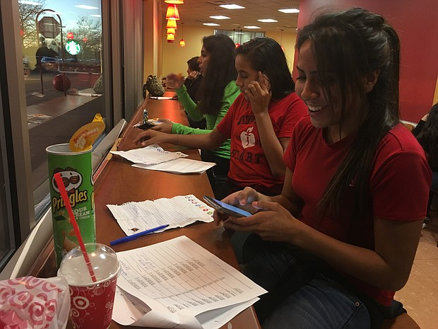 High school volunteers from the Southwest Suburban Immigrant Project call registered locals to make sure they go vote.