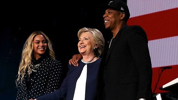 After raucous performances from Beyoncé and her husband, rapper Jay Z, Hillary Clinton had one simple message for the packed, ...
