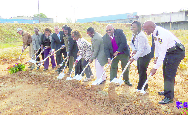 Officials from the city of Lithonia and Wendover Housing Partners LLC participate in a ceremonial ground breaking Nov. 9 for the Granite Crossing Apartments on the city-owned portion of Lithonia Plaza.