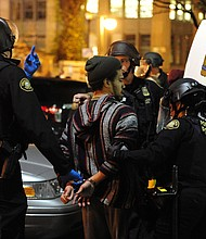 An arrest is made during a protest against Donald Trump's victory in the presidential election that turned violent in Portland Thursday night. (AP photo by Alex Milan Tracy/SIPA USA)