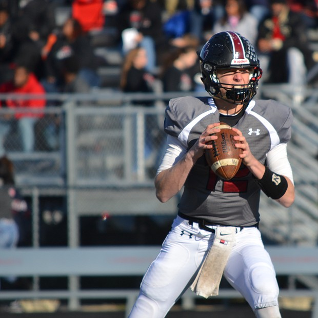 Plainfield North quarterback Brady Miller drops back to pass before his team's win against Rockford Auburn