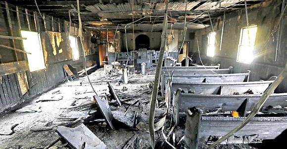 """After 111 years of worship, a historical African American church was set on fire and vandalized with the phrase """"Vote ..."""
