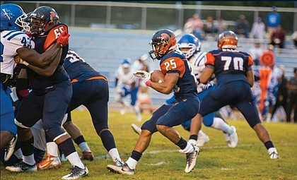 Virginia State University running back Trenton Cannon carries the ball, helping the Trojans to a 45-35 victory over Tuskegee University last Saturday in Alabama.