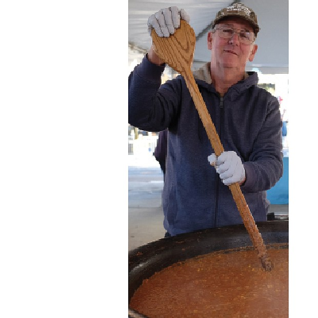 Soups on // The 17th Street Farmers' Market in Shockoe Bottom became a wonderful kitchen on Nov. 5 as Meredith Minter of Highland Springs, left, and other cooks stirred and served enormous vats of brunswick stew.