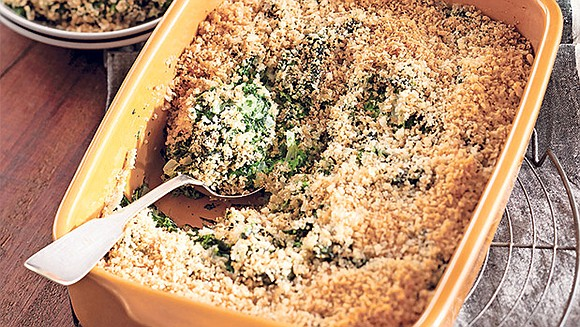 A shower of buttery, cheesy breadcrumbs covers creamy spinach in this recipe that's spot on for Thanksgiving. You can make ...