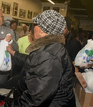 Rev. Al Sharpton hands out turkeys at the National Action Network for Thanksgiving.