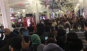 Demonstrators flood the entryway of Macy's on Black Friday.