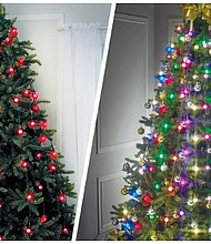 Tree Dazzler, a curtain of lights that hangs vertically over your Christmas tree.