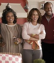 """From left to right: Kimberly Elise, Mo'Nique, Nicole Ari Parker, Danny Glover and Gabrielle Union star in """"Almost Christmas."""" (Universal Pictures)"""