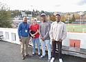 Lincoln High School Counselor James McGee (far left) with students Julian Calderon, Innocent Kisange and Akili Kelekele (left to right) promote a new Brothers of Color club that supports a sense of community at the southwest Portland school.