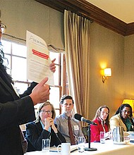 Darlene Lombos, executive director of Community Labor United, speaks at a Nov. 22 panel discussion on the privatization of government services in Massachusetts. Panelists included (l-r) Abby Scher of Political Research Associates; Jeremy Mohler of In the Public Interest; Neenah Estrella-Luna of  Northeastern University School of Public Policy and Urban Affairs; Nia Evans of Boston NAACP; and Chris Faraone of the Boston Institute for Nonprofit Journalism. Not shown: moderator Elena Letona of Neighbor to Neighbor.