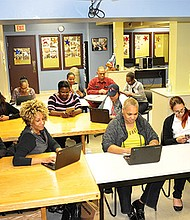 Entrepreneurs in a business class at Codman Square NDC.