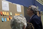 Mayor Jim Strickland looks at the ideas posted for Frayser improvement. (Photo: Brittney Gathen)