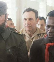 Presidents F. Castro of Cuba and J. dos Santos of Angola