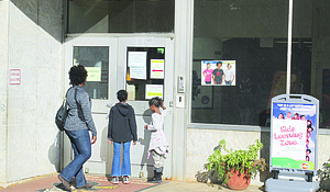 A parent and students enter Stone Mountain Elementary on Aug. 17. Inspectors found high lead levels in five water sources at the school in district-ordered testing.