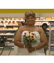 Mary Tinson walks down the aisle at Harvey's Supermarket in Albany, Georgia.