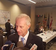 Metro board Chairman and D.C. Councilman Jack Evans (D-Ward) talks with reporters Dec. 1 after a board committee approved a proposal to curtail late-night service.
