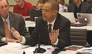 Metro board member Malcolm Augustine, who represents Prince George's County, pleads his case regarding the late-night service proposal during a committee meeting Dec. 1 at the agency's headquarters in northwest D.C.