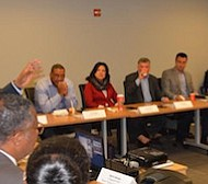 Prince George's County Economic Development Corporation President and CEO Jim Coleman (left) talks with local developers about new attraction strategies for premium retailers. (Courtesy of PGCEDC)
