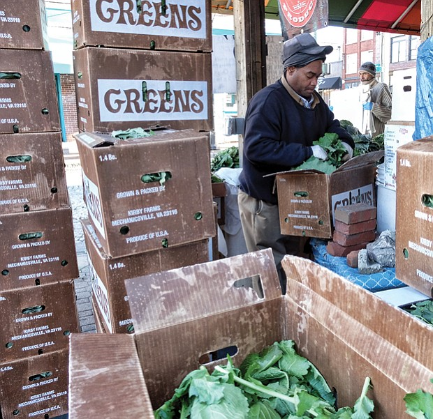 "Timothy Christian sorts through a box of fresh leafy greens as he prepares for holiday shoppers at the 17th Street Farmers' Market in Shockoe Bottom. Similar markets have sprouted in the Richmond area, but this market is the oldest. It has been a public gathering place since 1737, five years before Richmond was incorporated as a town. The site was designated as a ""public market"" in 1779, just a year before Richmond was officially named the state capital and three years before Richmond was designated an independent city. The city is to give the market area a facelift to create a more European-style plaza."