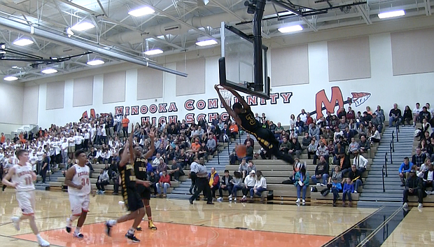 Joliet West's Eddie Creal dunks during his team's 63-35 win at Minooka to remain undefeated on Friday, December 2.