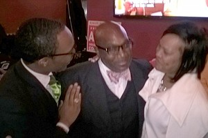 Gregory Adams (center) celebrates his apparent win over Randal Mangham in the Super District 7 runoff with wife Jacqueline and son Gabriel.