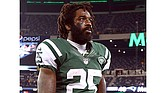 Joe McKnight of the New York Jets walks off the field after a game against the New England Patriots at MetLife Stadium on Nov. 22, 2012, in East Rutherford, New Jersey. On Dec. 1, former University of Southern California and New York Jets running back Joe McKnight was gunned down in a New Orleans suburb following a car accident. (Photo courtesty of Jim McIsaac/Getty Images via TheUndefeated.com)