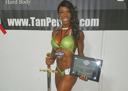 Andrea Green wins a first place trophy for natural bodybuilding at the recent Pro Elite World Championship