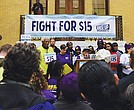 Labor activists rally in the State House for a $15 wage as part of a national day of action. The activists plan to press the Legislature to raise the state's minimum wage.