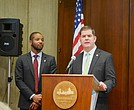 Mayor Martin Walsh speaks about the city's new Climate Ready Boston report, as Austin Blackmon, the city's Chief of Environment, Energy and Open Space looks on, at City Hall Dec. 8.