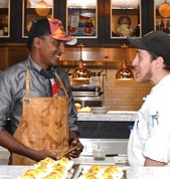 Renowned chef Marcus Samuelsson (left) displays a variety of dishes at his restaurant inside MGM National Harbor on Dec. 8, hours before the public grand opening of the casino resort.