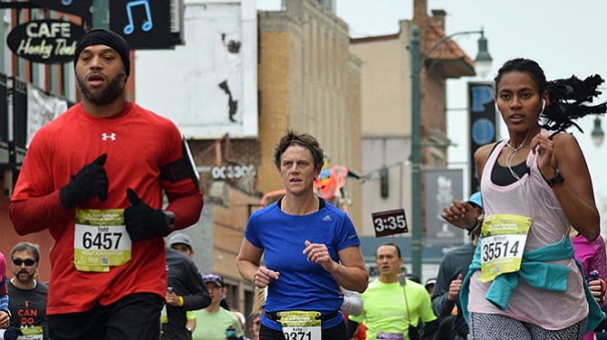 The thunder of runners resounded along Beale St. as runners, walkers and those combining both modes made their way along the route of the 2016 St. Jude Memphis Marathon.