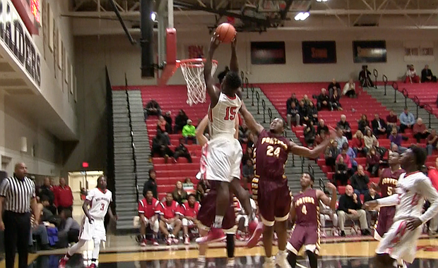 Bolingbrook forward David Lacey dunks on Lockport defenders during his team's 63-38 win on Thursday, Dec. 8.