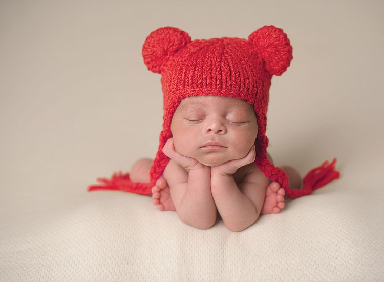 388a92db88a Cozy Red Hats Keep Babies  Heads Warm